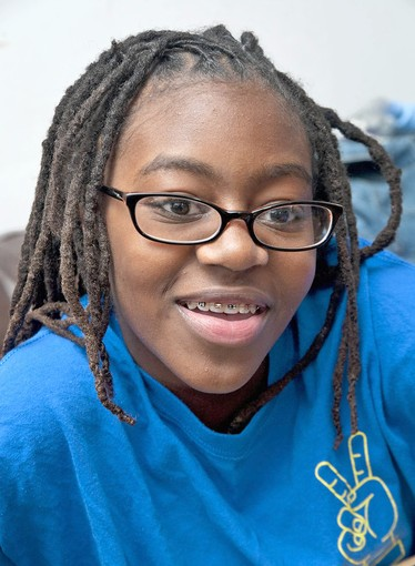 Danielle Cook, 13, an eighth-grader at Afya Public Charter School, is interested in applying to Cristo Rey, but she was told that her dreadlocks go against the high school's policy. Her mother, Dawnetta Jenkins, who takes care of Danielle's hair, also has dreadlocks. After inquiries from The Sun, the school said it was doing away with the policy.