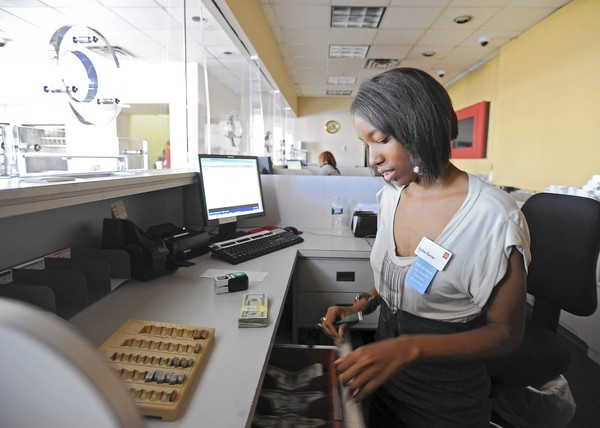 Baltimore, Md.--7/5/12-- Amber Barner, 20, was hired by Wells Fargo Bank through the Hire One Youth summer jobs program. However, she was not hired for the summer only but for a permanent full-time job as a bank teller. PHOTO BY: Kenneth K. Lam/The Baltimore Sun #DSC_6538 bz-baltimore-summer-jobs-p1 lam