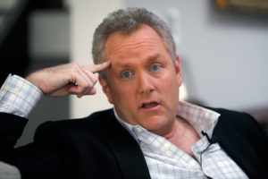 FILE - In this Feb. 11, 2010 file photo, conservative online publisher Andrew Breitbart is seen during an interview with the Associated Press at his home in Los Angeles Friday, Feb. 11, 2010. Shirley Sherrod, who was ousted from her job at the Agriculture Department, said Thursday she will sue Breitbart for posting an edited video of her making racially tinged remarks last week. (AP Photo/Reed Saxon, File)